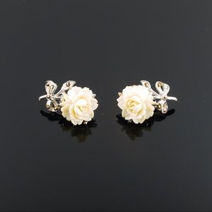 Vintage Napier Rose Earrings with faux Marcasite Accents White Celluloid Clip On